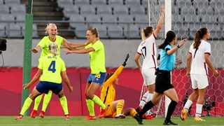 Stina Blackstenius of the Sweden celebrates with teammates after scoring their second goal as Alyssa Naeher and Abby Dahlkemper of the United States react. Photo: Edgar Su/Reuters