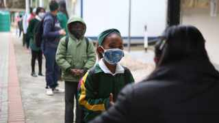 Students wait in line maintaining a safe social distance while being screened at Constantia Primary school as students return back to school in this file picture. Pictures: Brendan Magaar/African News Agency(ANA)