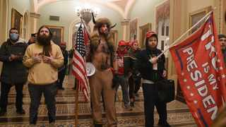 Supporters of US President Donald Trump breeched security and entered the Capitol as Congress debated the a 2020 presidential election Electoral Vote Certification. Photo by Saul Loeb/AFP
