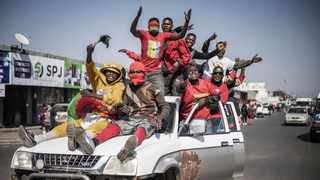 Supporters of Zambian President elect for the opposition party United Party for National Development (UPND) Hakainde Hichilema celebrate his victory. Picture: Marco Longari/AFP