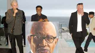 Surprise cocktail party for Sipho Hotstix Mabuse in Camps Bay ahead of his upcoming 70th birthday on November 2. Martin Myers, Sipho Hotstix Mabuse and artist, Dennis Woest. Picture : Tracey Adams/African News Agency (ANA)