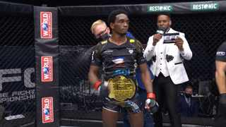 Sylvester Chipfumbu gets the gold Bantamweight strap wrapped around his waist by EFC Vice President, Graeme Cartmell. Picture: EFCWorldwide