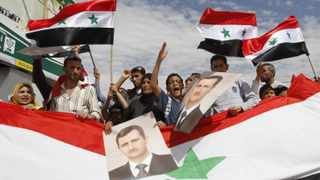Syrian security forces shot dead at least 30 demonstrators during protests that broke out across the country in defiance of a military crackdown.