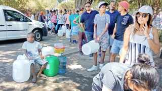 THIRSTY: People queue to collect natural spring water from the Brewery spring in Newlands. But inconsiderate people behaving badly are impacting on residents living nearby. Picture: Athina May.