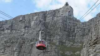 Table Mountain. Tourists took pictures of the cable car as it docked and left the cable station. Picture: Tracey Adams/African News Agency(ANA)