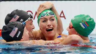 Tatjana Schoenmaker celebrates with Lilly King, Annie Lazor of the United States and Kaylene Corbett after setting a new World record. Photo: Carl Recine/Reuters