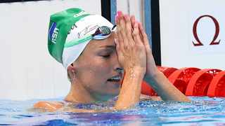 Tatjana Schoenmaker of South Africa reacts after breaking the 100m breaststroke Olympic record. Photo: Marko Djurica/Reuters