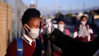 Teachers check the temperature of pupils at Sinethemba High School in Philippi. More pupils are set to return on July 6. Ayanda Ndamane African News Agency (ANA)
