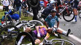 Team B&B KTM's Bryan Coquard of France (R) and a Team Alpecin Fenix' rider lie on the ground after crashing during the 1st stage of the Tour de France between Brest and Landerneau. Photo: Christine Poujoulat/AFP