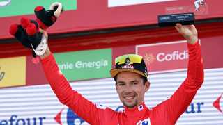 Team Jumbo's Slovenian rider Primoz Roglic celebrates on the podium wearing the overall leader's red jersey after the 6th stage of the 2021 La Vuelta cycling tour of Spain, a 158.3 km race from Requena to Cullera, on Thursday. Photo: Jose Jordan/AFP