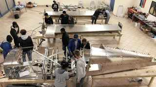 Teen plane builders work on their Sling-4 aircraft, which they will use on their journey from Cape to Cairo on June 12. Picture: Supplied