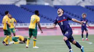Teji Savanier (11) of France reacts after scoring the winner in the final minutes of their Tokyo Olympics men's football Group A match against South Africa on Sunday. Photo: Kyodo Pictures/Reuters
