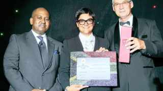 The 27four Stable Prescient Fund of Funds won the Raging Bull Award for the Best South African Multi-asset Equity Fund. Fatima Vawda, the managing director of 27four, accepts the award from Ellis Mnyandu, the editor of Business Report (Personal Finances sister newspaper), and Ryk de Klerk, the managing director of PlexCrown Fund Ratings.