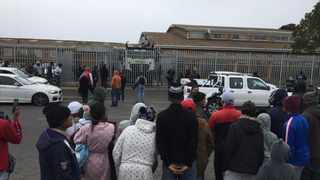 The Bishop Lavis community and media watch as accused in Western Cape top cop Lieutenant-Colonel Charl Kinnear's murder is whisked away in a Nyala which was heavily guarded behind the gate of the courthouse. Picture: Tracey Adams/African News Agency (ANA)