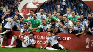 The German team celebrate after winning the Confederations Cup against Chile. Photo: Thanassis Stavrakis, AP