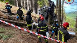 The Italian Firefighters 'Vigili del Fuoco' shows rescuers by a cable car that crashed to the ground in the resort town of Stresa on the shores of Lake Maggiore in the Piedmont region. Picture: Handout/ Vigili del Fuoco / AFP