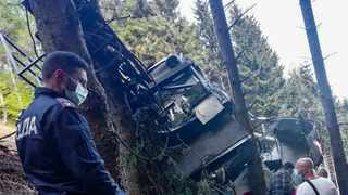 The Italian State Police (Polizia di Stato) shows police officers and rescuers by a cable car that crashed to the ground in the resort town of Stresa on the shores of Lake Maggiore in the Piedmont region. Picture: Handout/ Polizia di Stato / AFP