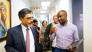 The Minister of Economic Development, Ebrahim Patel, is shown around the 22 on Sloane campus in Johannesburg by the co-chairperson of Global Entrepreneurship Network, Kizito Okechukwu. I Supplied