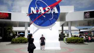 The NASA sign at the Kennedy Space Center visitors complex in Cape Canaveral, Florida. Picture: Carlos Barria/REUTERS