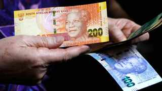 The Rand firmed on Friday and looked set for weekly gains, thanks to a rise in commodity prices and a weakening U.S. dollar as investors turned to riskier but high-yielding assets. Photo: AP Photo/Denis Farrell