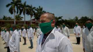 The SA Medical Association slated the government for bringing in just over 200 Cuban medical experts to help in the fight against the coronavirus. File picture: AP/Ismael Francisco