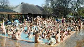 The South African National Naturist Association broke its record of 264 people jumping into a pool naked on Spring Day this year.