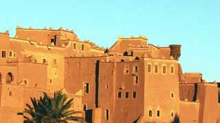 The Taourirt Kasbah in the Draa Valley of southern Morocco glows as sunset. Illustrates TRAVEL-MOROCCO (category t), by Carol Huang, special to The Washington Post. Moved Tuesday, March 25, 2014. (MUST CREDIT: Mark Hannaford/John Warburton-Lee Photography Ltd.)