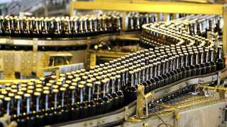The alcohol industry has slammed the government's decision to ban alcohol sales over the weekends with fears that the country's largest brewer, SAB, could once again withhold its intended R2 billion capital investment in the country. Photo: REUTERS/Siphiwe Sibeko/Files