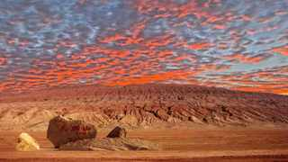 The carmine barren land, once a symbol of struggle and unbearable poverty, has now come to represent prosperity.