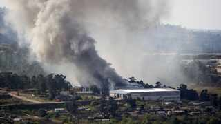 The cold storage unit in Hammarsdale, KZN, on fire after being looted on July 18. Picture: Bongani Mbatha /African News Agency (ANA)