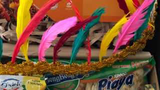 The festival kit in week one included feathers to make a headdress and some delicacies.