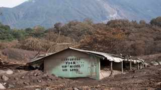 """The heavily damaged community center of San Miguel Los Lotes still stands after the Volcan de Fuego or """"Volcano of Fire"""" eruption, . Guatemala's national disaster agency suspended search and rescue efforts at the zone devastated by the eruption of the Volcano of Fire, saying climatic conditions and still-hot volcanic material makes it dangerous for the rescuers. (AP Photo/Moisés Castillo)"""