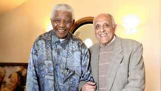 The late former South African president Nelson Mandela, who won the Nobel Peace Prize in 1993, stands with his friend anti-apartheid veteran Ahmed Kathrada. File photo: Debbie Yazbek/Nelson Mandela Foundation