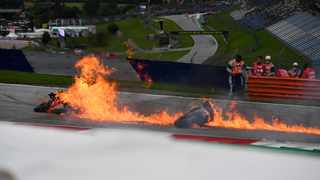 The motorbikes of Lorenzo Savadori and Dani Pedrosa caught fire after a crash after the start of the Styrian Grand Prix. Picture: Joe Klamar / AFP.