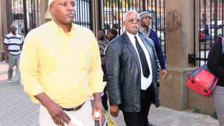 The parents of murdered Masego, Joseph Kgomo, left, and Kate, right, leave court with a family member. Picture: Sizwe Ndingane