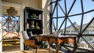 The peaceful study area in the extraordinary bedroom of The Silo Hotel penthouse overlooks Lion's Head and Signal Hill. Picture: The Silo Hotel