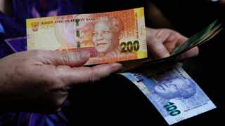 The rand was hovering around three-month lows in early trade on Wednesday, as the country prepared for what could be another day of unrest linked in part to anger over poverty and economic inequality. Photo: AP Photo/Denis Farrell