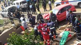 The red VW Polo that ploughed into 4 workmen and a property in Phoenix in 2015, after the driver of vehicle allegedly failed to negotiate a sharp bend on a narrow street in the area. Picture: Supplied