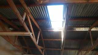 The roof of Dibeng Primary School. Residents have started removing the corrugated iron roof of the school and were building three shacks to house the learners. Picture: Supplied