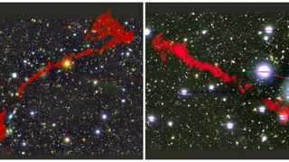 The two giant radio galaxies found with the MeerKAT telescope. In the background is the sky as seen in optical light. Overlaid in red is the radio light from the enormous radio galaxies, as seen by MeerKAT. Photo: Dr Ian Heywood (Oxford/Rhodes/SARAO)