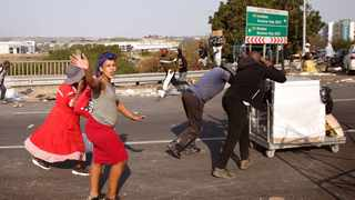 The violence and looting that took place in KwaZulu-Natal and Gauteng last month set back our struggle for a non-sexist and non-racist society, says the writer. Picture: Motshwari Mofokeng/African News Agency (ANA)