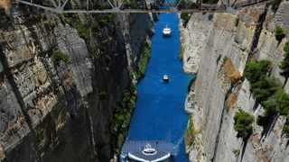 The world's largest solar-powered boat, MS Turanor PlanetSolar sails through the Corinth Canal near the town of Corinth. The boat arrived in Greece as part of a joint archaeological project focused on underwater exploration off one of Europe's oldest human occupation sites, the Franchthi cave in the Argolid, southeast Peloponnese.