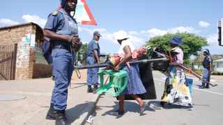 There was a police presence as street vendors were forced to close their stalls due to University of Limpopo students protesting against increased fees for 2016. Picture: African News Agency