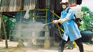 This file photo dated 24 March, 2006 shows a Cambodian health worker spraying disinfectant at the Korng Pisey district in Kampong Speu province, nearby where three-year Mon Vuthy died of bird flu.