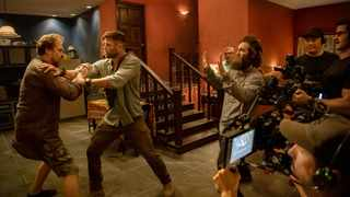 """This image released by Netflix shows actors David Harbour, from left, and Chris Hemsworth being directed by Sam Hargrave for a scene in the action film """"Extraction."""" Picture: Jason Boland/Netflix"""