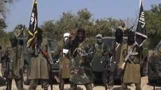 This still image, captured from a video obtained by AFP, shows Boko Haram leader Abubakar Shekau (centre) delivering a speech. Picture: AFP