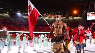Tokyo 2020 Olympics - The Tokyo 2020 Olympics Opening Ceremony - Olympic Stadium, Tokyo, Japan - July 23, 2021. Flag bearers Malia Paseka of Tonga and PitaTaufatofua of Tonga lead their contingent during the athletes' parade at the opening ceremony REUTERS/Kai Pfaffenbach