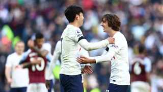 Tottenham Hotspur's Son Heung-min and Bryan Gil celebrate after their Premier League match against Aston Villa at theh Tottenham Hotspur Stadium in London on Sunday. Photo: David Klein/Reuters