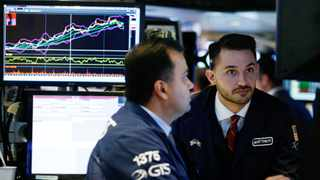 Traders work on the floor of the New York Stock Exchange, (NYSE) in New York