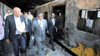 Transport Minister Fikile Mbalula and Passenger Rail Agency of SA officials conduct an inspection at Cape Town station after 18 train carriages were burnt. Picture: Armand Hough / African News Agency (ANA)